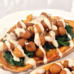 Chickpea-Stuffed Sweet Potatoes with Garlic Spinach and Tahini Sauce